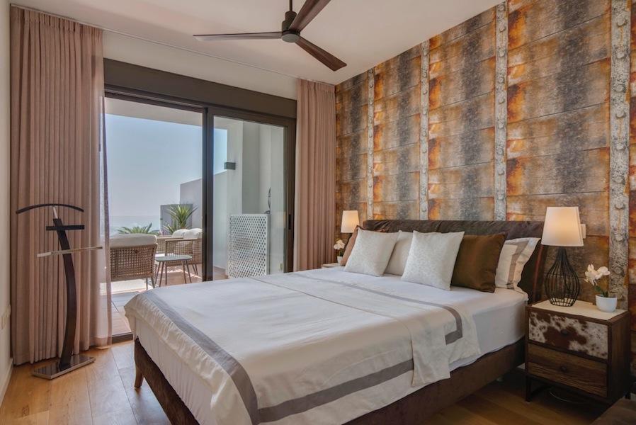 The_Suites_320-Master_bedroom.jpg